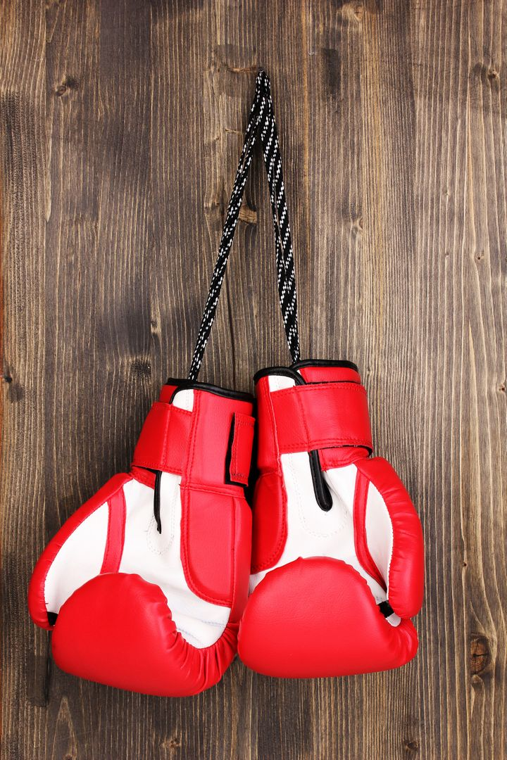 red boxing gloves hanging on...