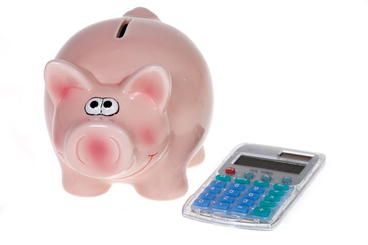 smiling pink piggy bank and a...