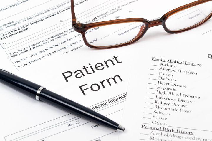 pen  glasses and patient form...