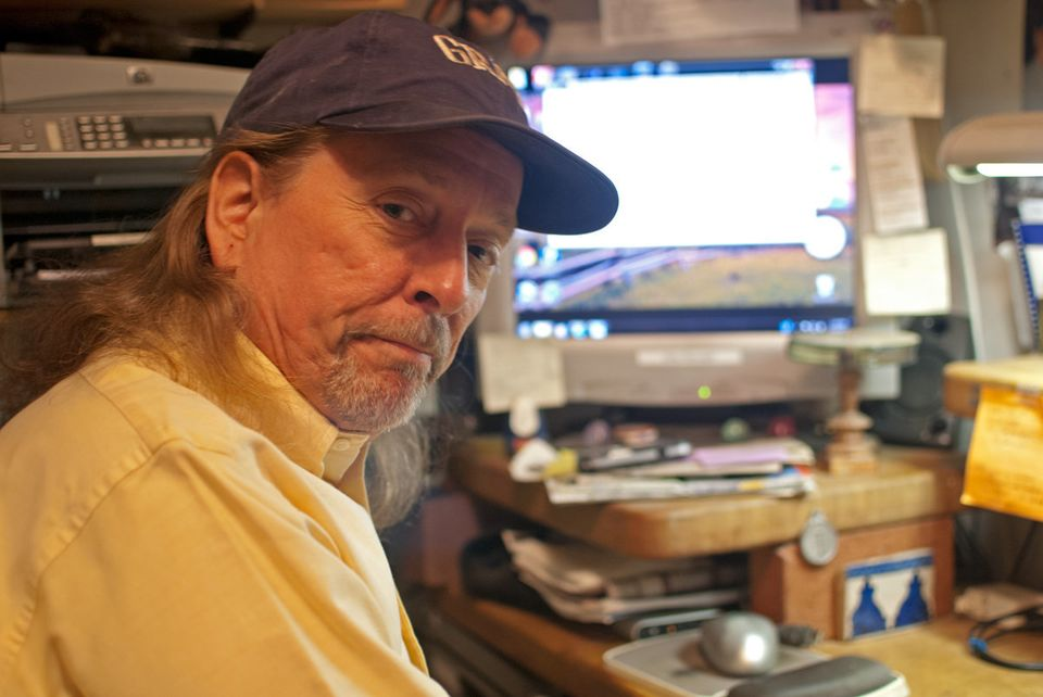 Basnight sitting in his office, a converted walk-in closet in his New York City apartment.