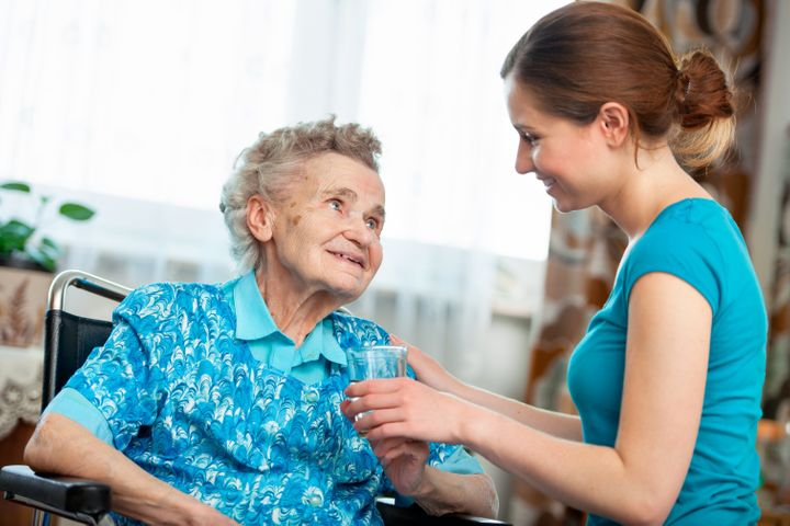 senior woman with her caregiver ...