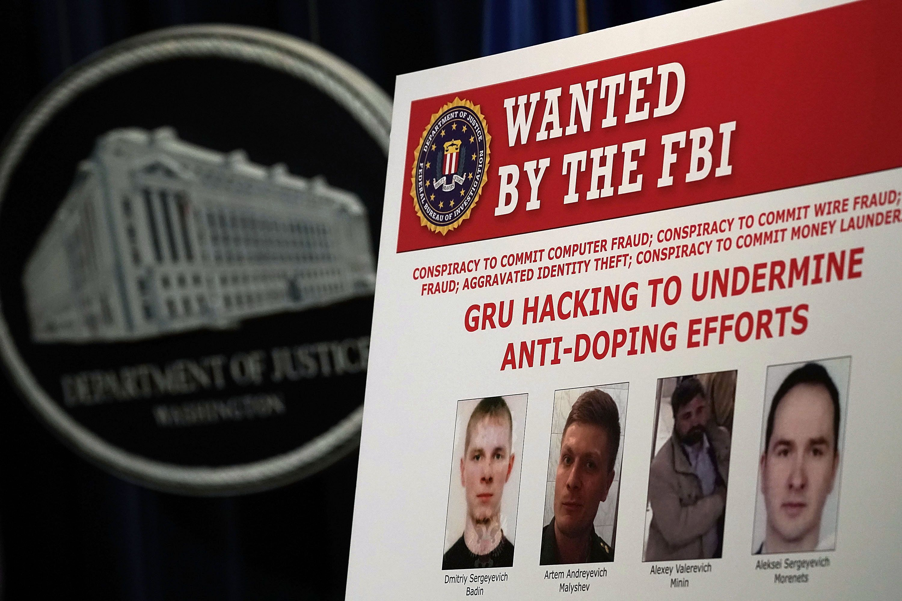 WASHINGTON, DC - OCTOBER 04:  A 'WANTED' poster of Russian individuals is seen during a news conference to announce criminal charges October 4, 2018 in Washington, DC. Seven Russian GRU intelligence officers have been indicted for their alleged roles in hacking and related influence and disinformation operations targeting international anti-doping agencies, sporting federations and anti-doping officials.  (Photo by Alex Wong/Getty Images)