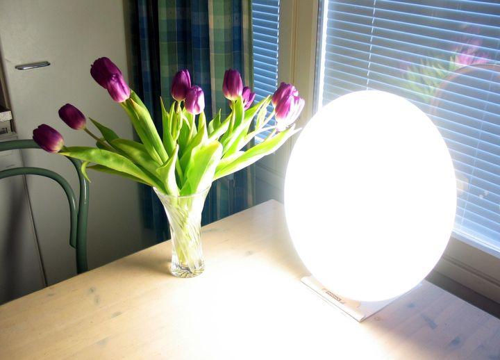 Description A 30 kHz bright light therapy lamp (Innosol Rondo) used to treat seasonal affective disorder .  Provides 10,000 l