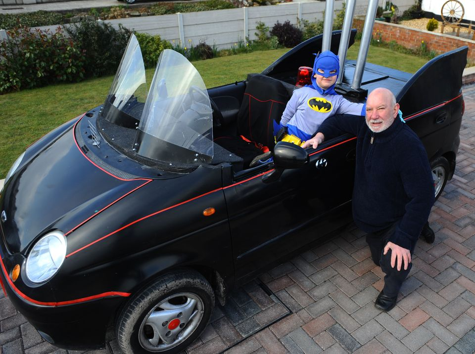 Grandfather Allan Bennett who has built his granson Alfie Wilde a batmobile, in Rhyl, North Wales.