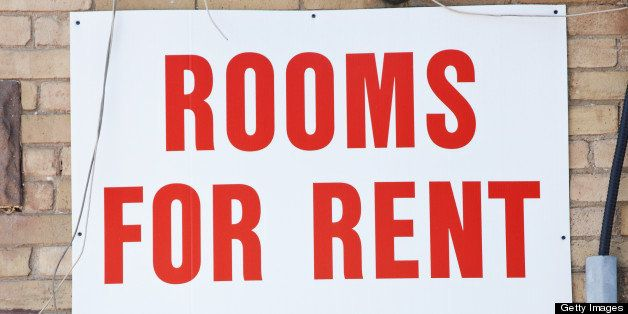 Rooms for rent sign on brick wall