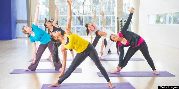 Women exercising together in class