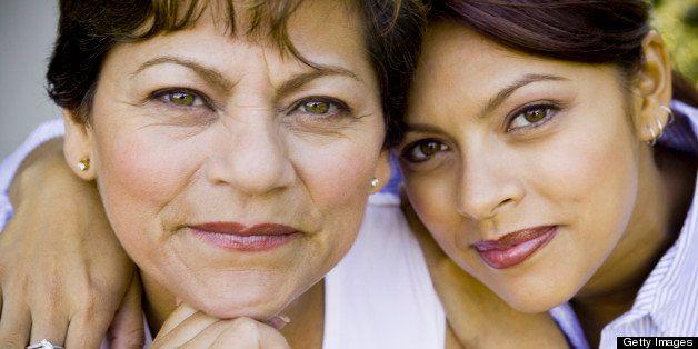 Daughter hugging mother, smiling, close-up, portrait