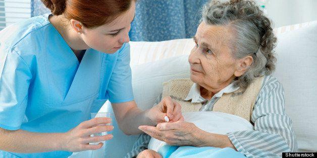 nurse cares for a elderly woman ...