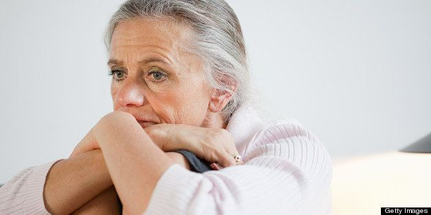 Mature woman looking anxious