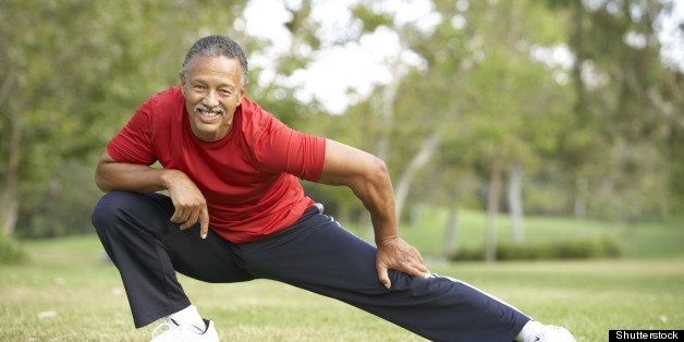 senior man exercising in park