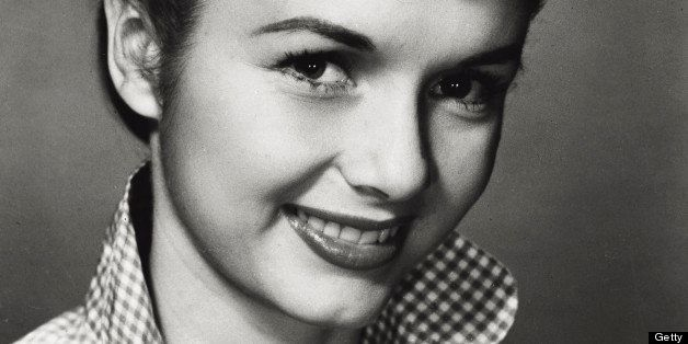 Portrait of American actress and singer Debbie Reynolds smiling. 1950s (Photo by Mondadori Portfolio via Getty Images)