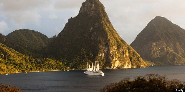 The World Heritage Twin Pitons framed by  beautiful huge five-masted sailing ship 'Club Med 2'.