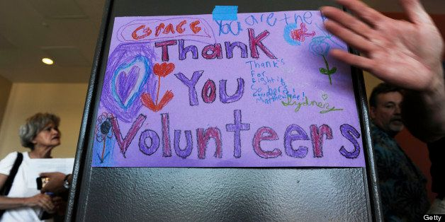 PALMER, CO - JUNE 15:  Black Forest Fire evacuees were greeted to  sign thanking volunteers at a community meeting at Palmer