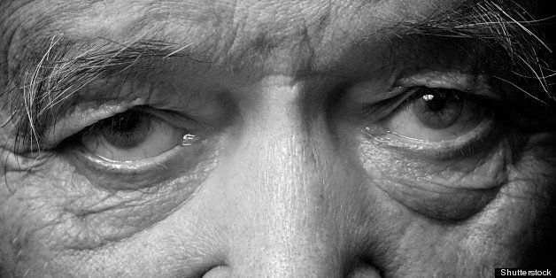 old man face part closeup eyes...