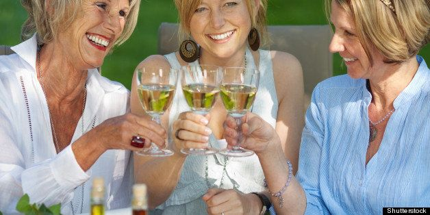 happy women saying cheers with...