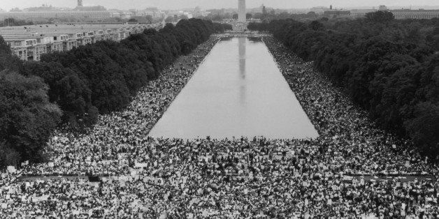 Photograph of crowd gathered with Washington Monument in background in Washington DC circa 1964, when Martin Luther King gave