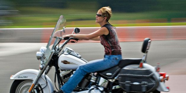 UNITED STATES - SEPTEMBER 07:  A woman rides her Harley-Davidson motorcycle from the parking lot at the A.D. Farrow Harley-Da