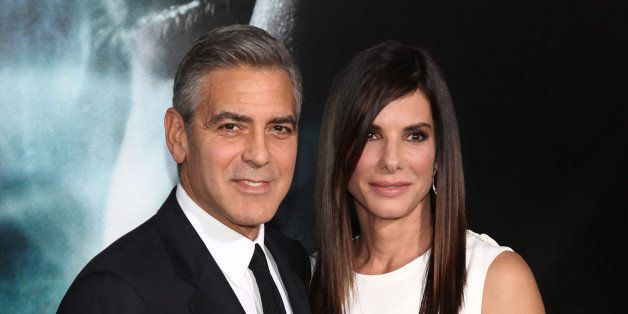 NEW YORK, NY - OCTOBER 01:  Actors George Clooney and Sandra Bullock attend the 'Gravity' premiere at AMC Lincoln Square Thea