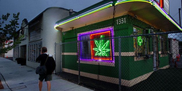 A pedestrians walks past the Little Green Pharmacy medical cannabis dispensary in Denver, Colorado, on Tuesday, August 2, 201