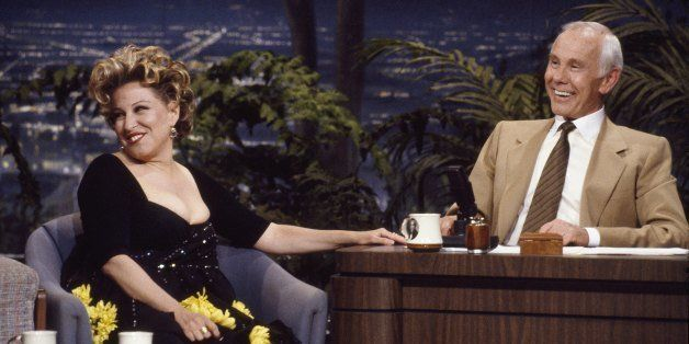 THE TONIGHT SHOW STARRING JOHNNY CARSON -- Episode -- Pictured: (l-r) Actress/singer Bette Midler during an interview with an