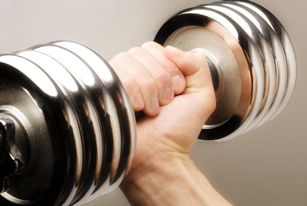 Your muscles may not look any different after a few weeks of weight training, but they've actually become smarter and more ef