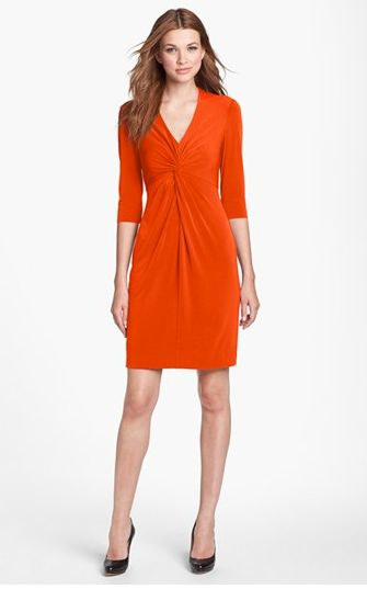 The twist-front design adds a little visual interest, sprucing up an office or after hours look. An attractive v-neckline com