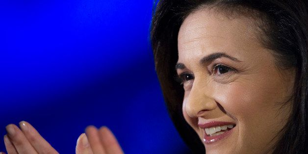 Sheryl Sandberg, chief operating officer of Facebook Inc., reacts during a demonstration at the DreamForce Conference in San