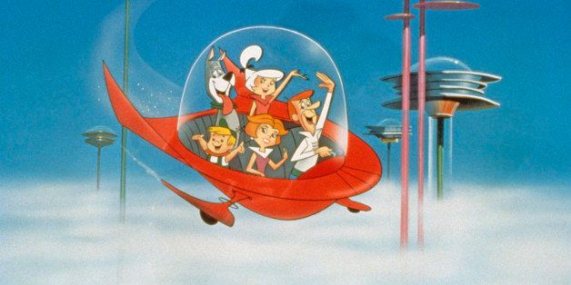 The Jetson family wave as they fly past buildings in space in their spaceship in a still from the animated television series,