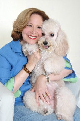 It all started with a white fluffy poodle named Coco the Love Dog. Nineteen years ago, when Sue Grundfest was recovering from