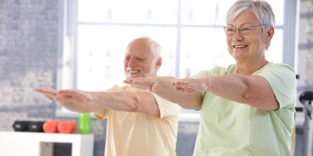 mature people exercising...