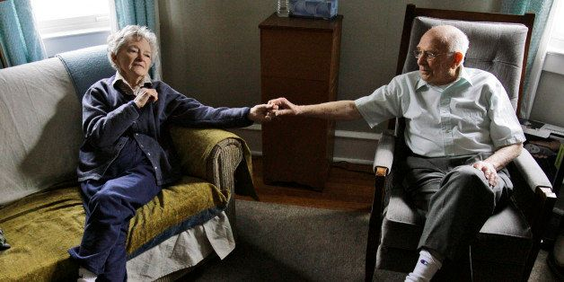 Alzheimer's patient Dorothy Eckert and her husband John Eckert's hold hands at their home  in Norristown Pa., Thursday, April