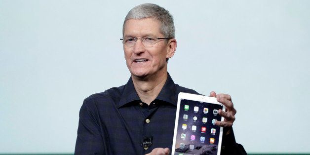 Apple CEO Tim Cook introduces the new Apple iPad Air 2 during an event at Apple headquarters on Thursday, Oct. 16, 2014 in Cu