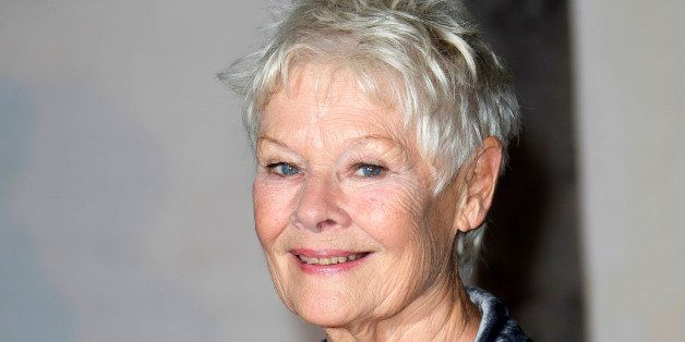 FILE - This Oct. 17, 2013 file photo shows British actress Judi Dench at the Globe Theatre in central London, for a Gala even
