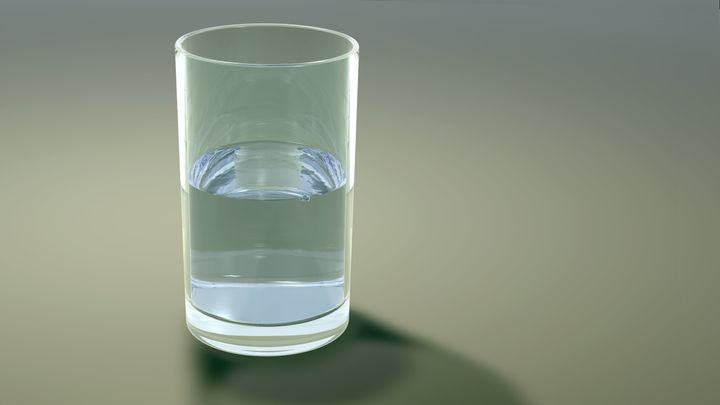 glass half full of water or...
