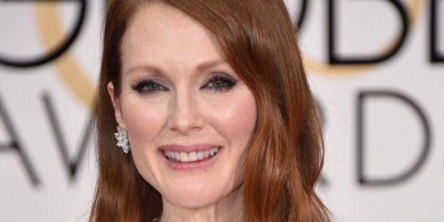 Julianne Moore arrives at the 72nd annual Golden Globe Awards at the Beverly Hilton Hotel on Sunday, Jan. 11, 2015, in Beverl