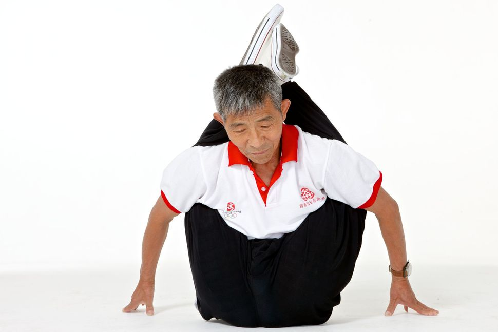 Duan Tzinfu, 76, demonstrates his amazing flexibility. He only started training when he turned 60. Before he started training