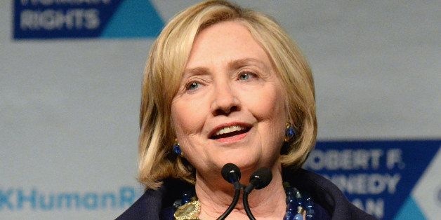 NEW YORK, NY - DECEMBER 16:  Honoree Hillary Rodham Clinton speaks onstage at the RFK Ripple Of Hope Gala at Hilton Hotel Mid