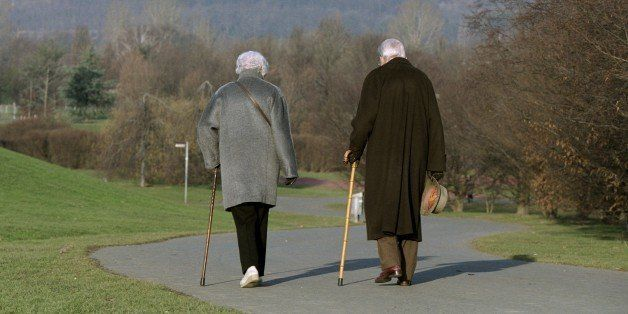GERMANY - FEBRUARY 11: Spring walk,,, Old couple talking a walk in a park. (Photo by Ulrich Baumgarten via Getty Images)