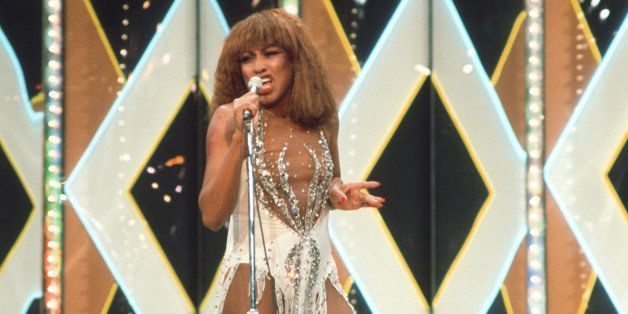 SEPTEMBER 1971:  Tina Turner of husband-and-wife R&B duo Ike & Tina Turner performs onstage in a skimpy white dress in Septem