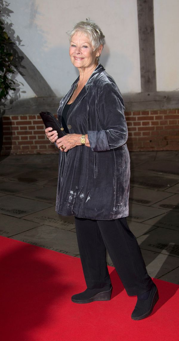 Only this Dame could get away with wearing a grey velvet jacket.