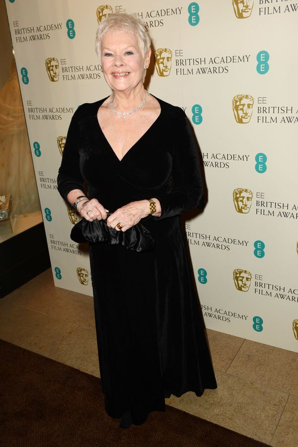 At the EE British Academy Film Awards, Dame Dench looks stunning in a plunging black gown.