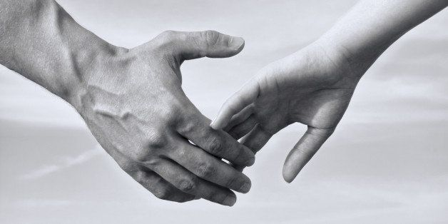 Man and woman holding hands, black and white photo