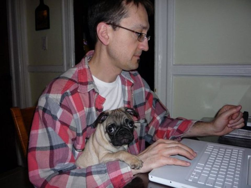 Teddy (as a puppy) helping my hubby (Paul Morin) work from home.