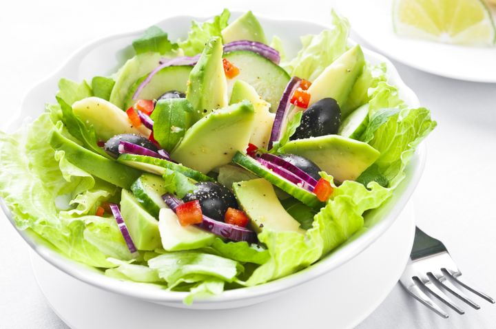 Salad with avocado, black olives, red onion and cucumber