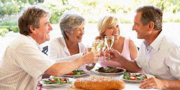 Friends Eating An Al Fresco Lunch, Holding Wineglasses