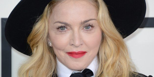Madonna arrives at the 56th annual GRAMMY Awards at Staples Center on Sunday, Jan. 26, 2014, in Los Angeles. (Photo by Jordan