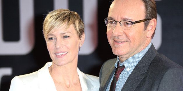 Actors Kevin Spacey and Robin Wright pose for photographers upon arrival at the House of Cards season 3 World Premiere at the