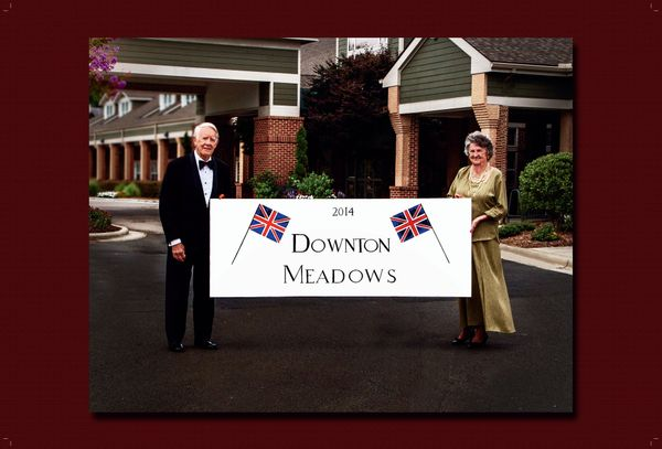 "Carolina Meadows residents Mariechen Smith and George Evans welcome visitors to ""Downton Meadows"" with a beautiful, hand-pain"