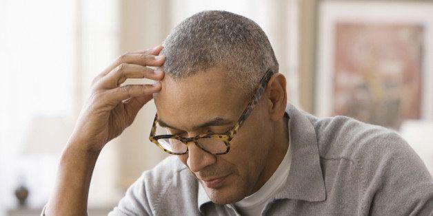 Mixed race man using digital tablet
