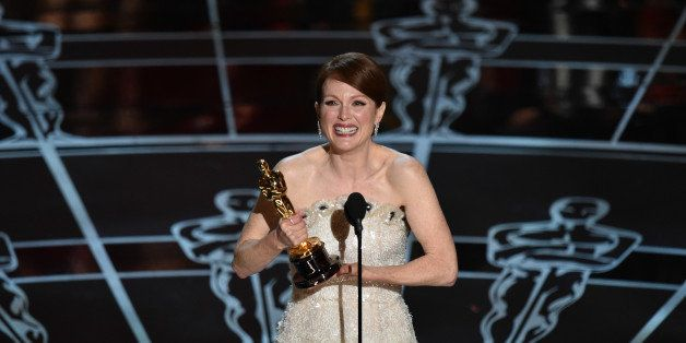 """Julianne Moore accepts the award for best actress in a leading role for """"Still Alice at the Oscars on Sunday, Feb. 22, 2015"""
